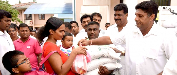 Distribution of dry food rations and necessary relief items to the people affected by floods
